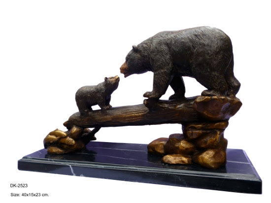 2 bronze bears on log