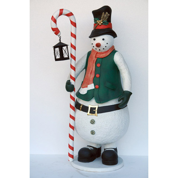 Snowman with candle stick and lantern